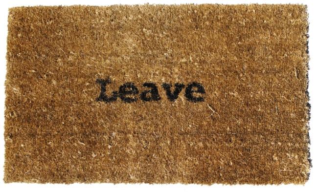 Doormat that says 'leave'