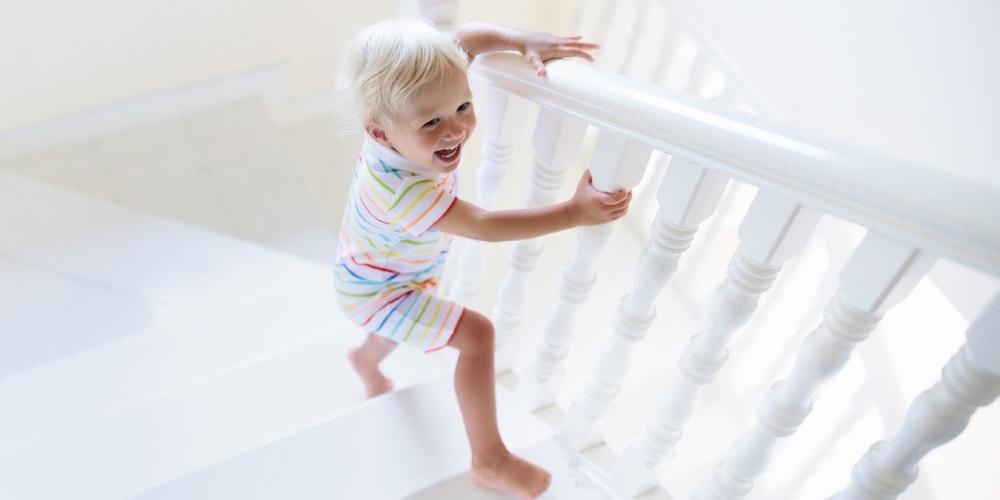 boy on white staircase